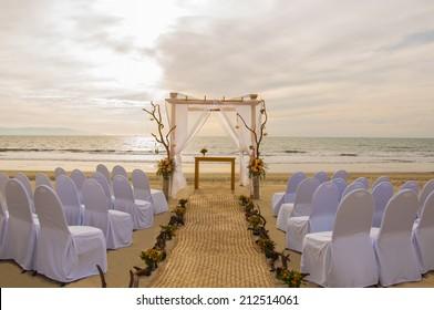 wedding on the beach scene with sunset