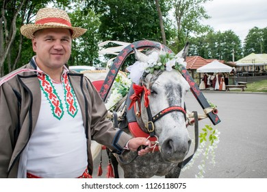 Wedding on an old wagon with a coachman and horses in the city of Nesvizh Belarus, Nesvizh Castle Museum June 30, 2018