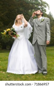 Wedding pair drinking a health