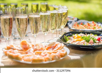 Wedding party buffet with champagne, canape, sandwiches