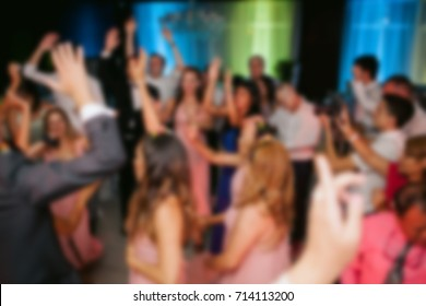 Wedding party. people are dancing at a party. blurred image. Blurred image of a wedding party in a restaurant, for a background.