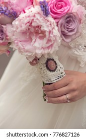 wedding peonies & roses bouquet detail with brooch