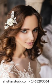 Wedding. Perfect fashion model woman with beautiful hairstyle. Elegant hair accessorie. Studio indoor photo.