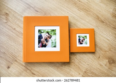 Wedding photo album and CD box with orange leather cover and passe-partout
