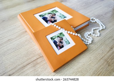 Wedding photo book and CD box with orange leather cover and passe-partout