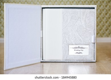 Wedding photo book with leather combined cover and metal shield in box for wedding photo book