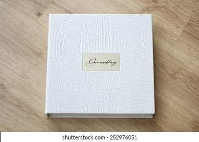 Wedding photo book with leather cover and metal shield.