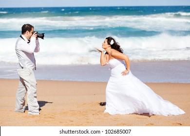 wedding photo shoot - groom taking bride's photo