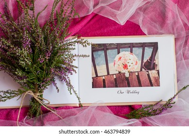 Wedding photobook on a pink background
