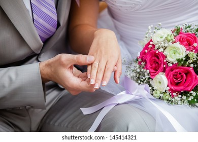 Wedding photograph of a young couple of lovers who are just married, are close to each other in harmony, love and happiness.