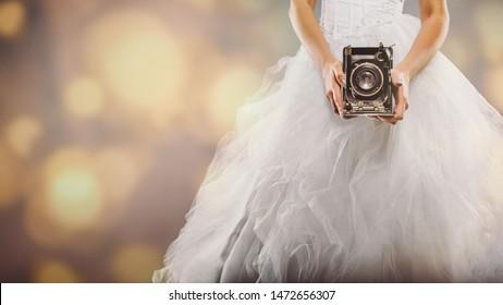 wedding photography - bride with retro camera