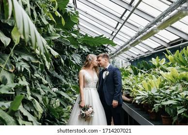 wedding photos of a couple in the interiors and Botanical garden