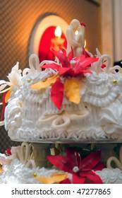 Wedding pie with figures of groom and bride