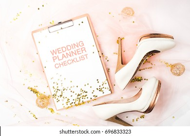 Wedding Planner Checklist. Female shoes and golden decorations. Flat lay, top view trendy holiday concept.