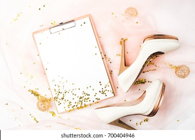 Wedding planner schedule calendar and shoes and golden decorations. Flat lay, top view trendy holiday concept.