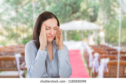 wedding planner woman is organizing  the wedding reception venue for her customers standing and stressed for lack of time at the wedding place
