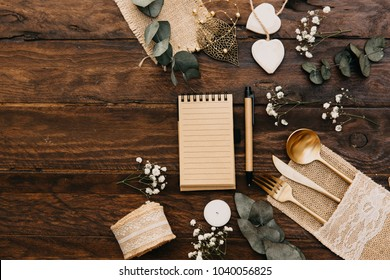 Wedding planning concept. Flat lay composition with boho wedding decorations over wooden background. Top view, copy space