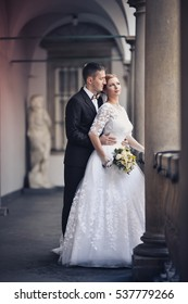 Wedding portrait of two lovers just married newlyweds photo in the middle of a big city, bouquet, wedding, couple