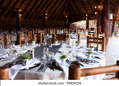 Wedding reception decor under thatch roof