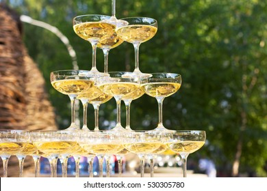 Wedding reception outdoors. The champagne glasses. Banquet. The celebration outdoors.