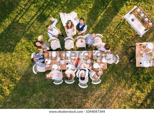 Wedding reception outside in the backyard.