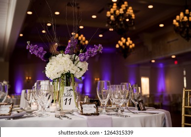 Wedding reception with purple uplights
