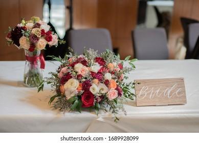 Wedding reception table signage showing bride