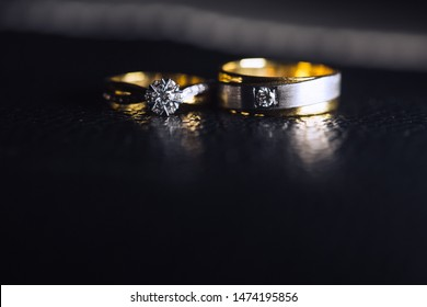 Wedding ring for bride and groom on wedding day. Couple ring. Diamond ring for couple.