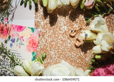 wedding ring with flowers on a gold backgraund
