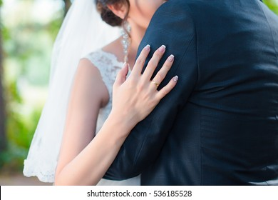 A wedding ring on the finger of the bride