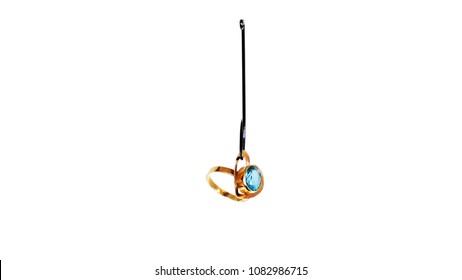 Wedding Ring On A Fishing Hook Isolated On White Background