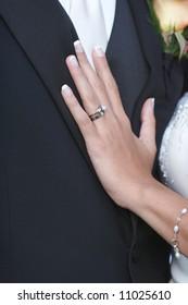 Wedding ring on hand of bride on groom
