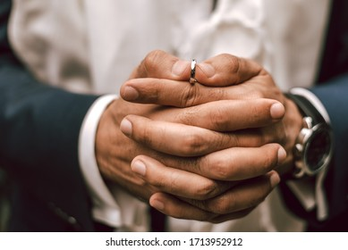 wedding ring on the hands of the groom