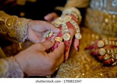 wedding ring on a Muslim bride