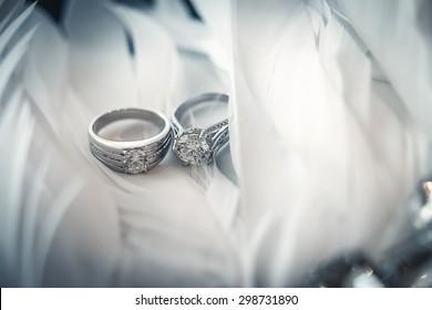 wedding ring on plumage
