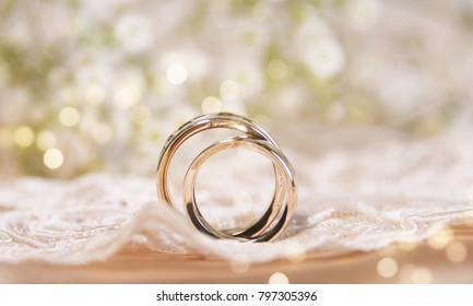 Wedding ring on the vintage lace