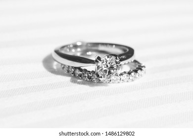 Wedding ring placed on a bed before ceremony starts ,