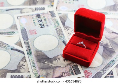 Wedding Ring in red box with yen banknotes in background
