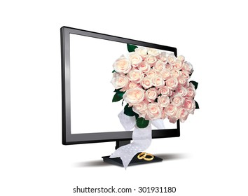 wedding rings and bouquet of flowers near the monitor