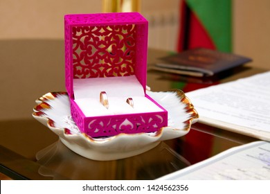 wedding rings in the box at the ceremony of marriage registration, wedding attributes