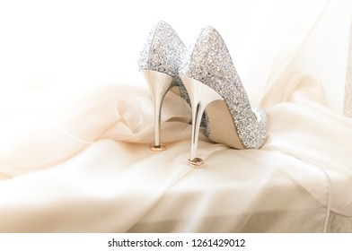 Wedding rings with bride shoes
