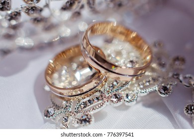 Wedding rings and bride's earrings