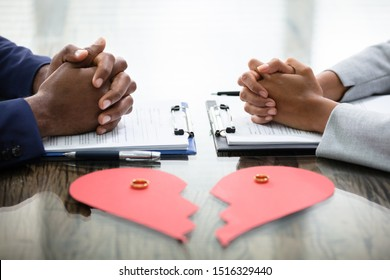 Wedding Rings And Broken Heart Over Desk