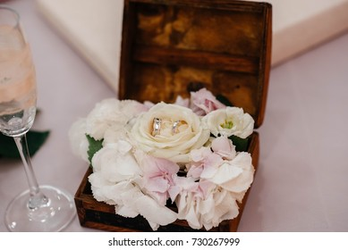 Wedding rings in the casket during the wedding ceremony.