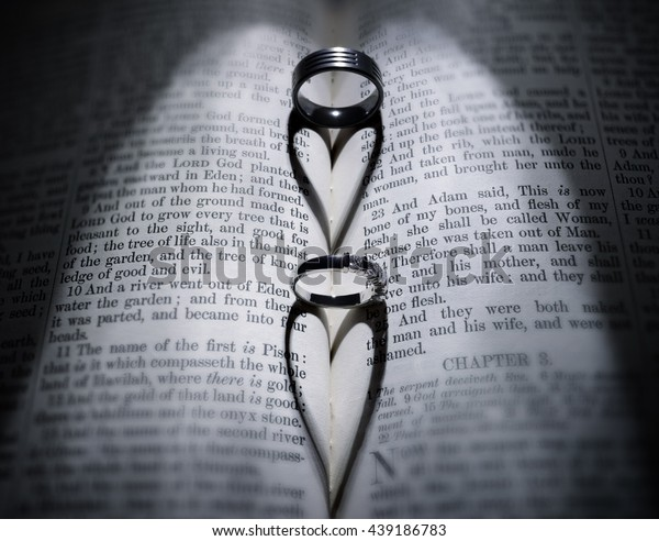 Wedding Rings Casting Heart Shaped Shadow Stock Photo (Edit