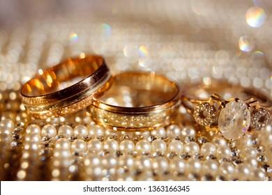 Wedding rings close up on shining background