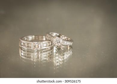 Wedding rings closeup on mirror