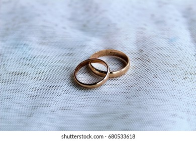 Wedding rings - composition on a light background.