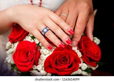 Wedding rings. Wedding couple holding hands on sunset background