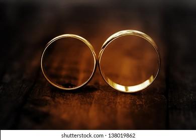 Wedding rings in dark. Black and white style.